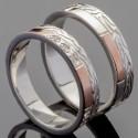 Пара обручальных колец из серебра и золота с узором