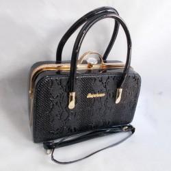 Женская сумочка-саквояж с тиснением
