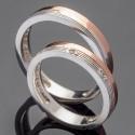 Пара свадебных колец из серебра и золота с узором
